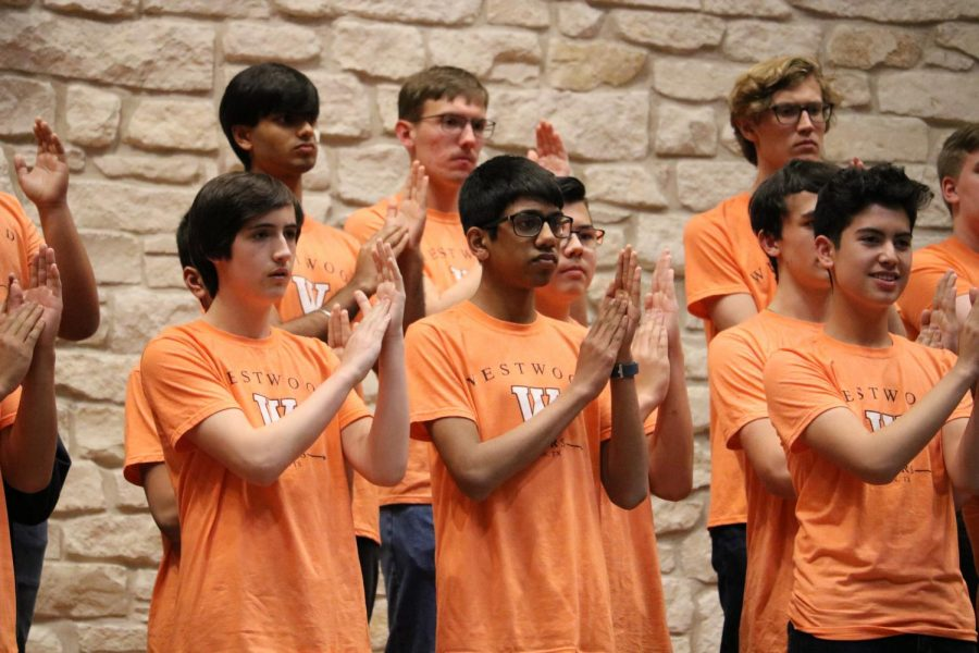 The men in Chorale Mixed clap as part of one of their pieces. The group consists of the Chorale Mixed choir merged with the Concert Men.