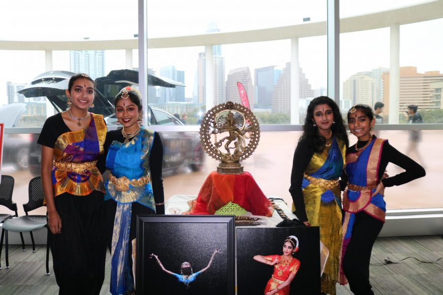 Students from the Nataraja Indian Dance Demonstration pose by their xLab in traditional Bharatnatyam costumes, getting ready to dance. Bharatnatyam is an Indian dance form that incorporates facial expressions and gestures to convey Hindu mythologies.