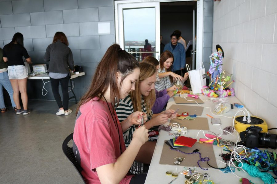As part of Austin Creative Reuse's xLab, students used various art supplies such as fabric, beads, and hot glue guns to make crafts. They were allowed to make anything they wanted to and could even take materials home to continue them.