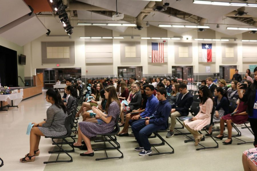 New NFHS members sit in the cafeteria waiting for the induction ceremony to begin. Their parents and family members were invited to attend as well.