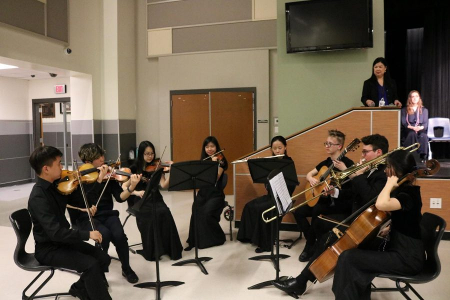 NFHS members in the orchestra entertain the audience with various French songs, including 'La Marseillaise', the French national anthem. Their performance was conducted and directed by Hannah Lu '20.