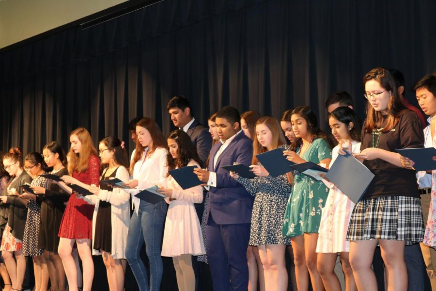 Students read the NFHS pledge from their certificates. This prepares them for the honor and responsibility that comes with being a member.