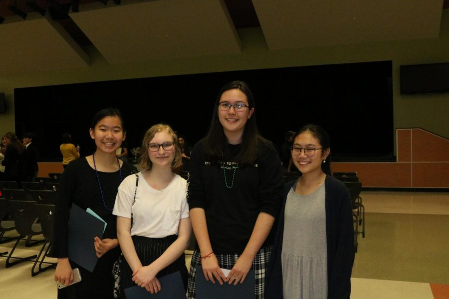 Sophomores Sarah Qi, Melissa Brown, Willow Stenglein, and Helena Zeng pose after the ceremony. They would then proceed to eat refreshments.