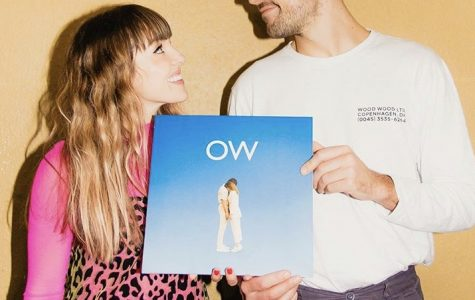 Josephine Vander Gucht and Anthony West pose for a picture with their new album. This is their third studio album together. Photo Courtesy of @ohwondermusic.