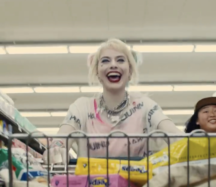 Main character, Harley Quinn, laughs in the middle of a grocery store. Photo Courtesy of @birdsofprey Instagram.