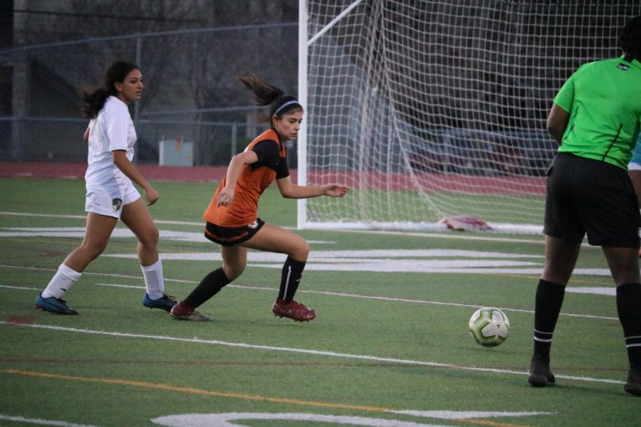 Maya Berdeja '22 runs toward the ball in hopes of getting a chance to score a goal for the team.