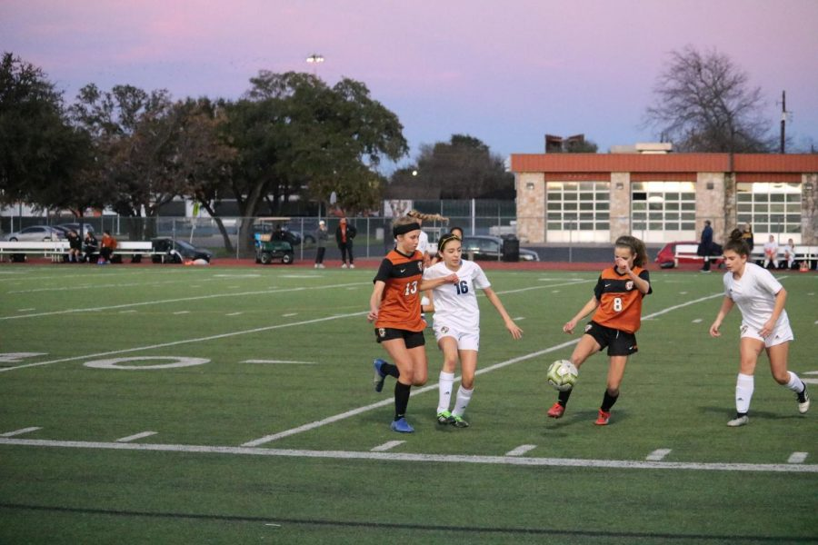 Sasha Brown '23 passes the ball to Tayte Webster '23 before a Leander player could get to it.