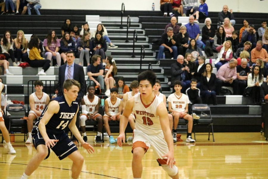 Point guard Robbie Jeng '21 goes around an enemy Tiger to try and get to where his teammate can pass him the ball. This was the last home game for the JV boys' basketball team this season.