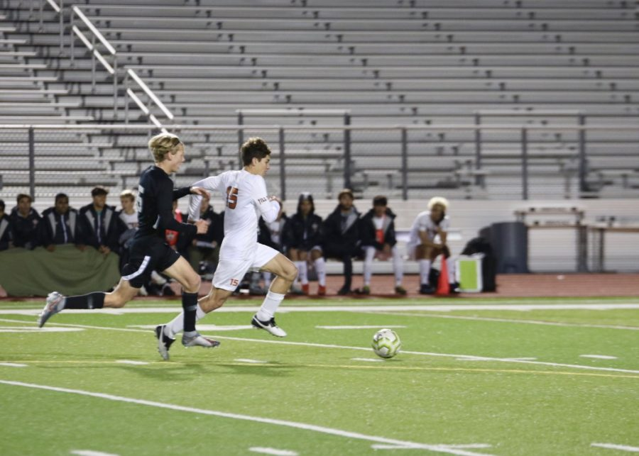 Sprinting up the field, Luca Cipleu '21 is on the attack. This was during the second half, so the tensions were high.
