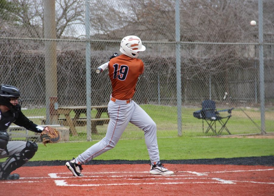 Sam Kainer '21 swings and hits the ball into play. After this hit, Kainer made it to first base.