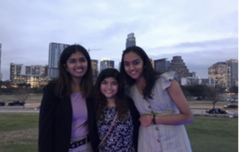 Sudiksha Pradhan '21, Shawkin Kabir '21, and Sruti Mohankumar '21 pose for a photo outside the Long Center for the Performing Arts. They were one of the groups who won the 'Raise Your Voice' Award. Photo courtesy of Shawkin Kabir '21.