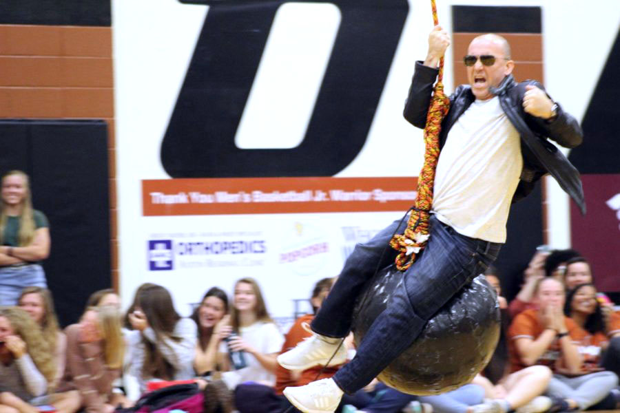 Principal Dr. Mario Acosta lip-syncs to 'Wrecking Ball' by Miley Cyrus. All of the students cheered as he performed.