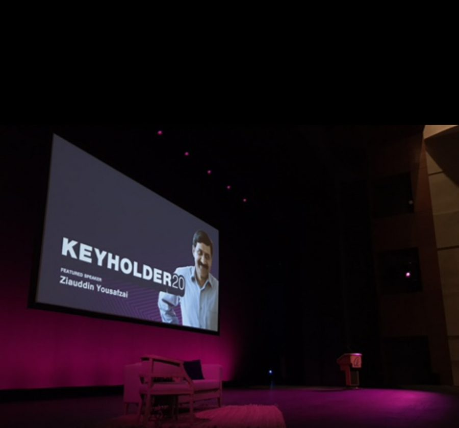 A projector displayed a picture of Ziauddin Yousafzai, who is Malala's father, on the main stage. He was the keynote speaker of the event and discussed the importance of women's empowerment in the world.