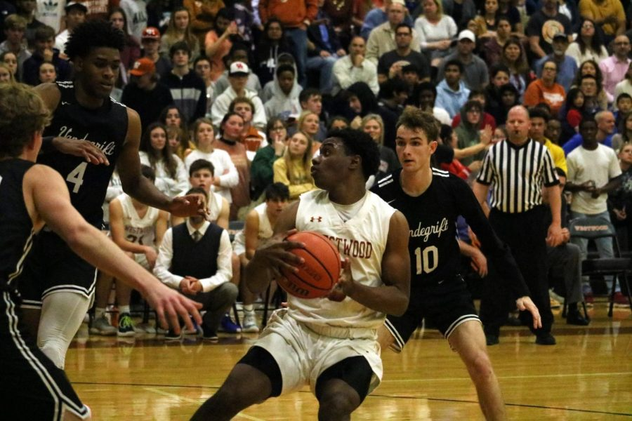 Brandon Parks '20 is surrounded by Vandegrift players. Parks was able to maneuver around the vipers and pass the ball to a teammate.