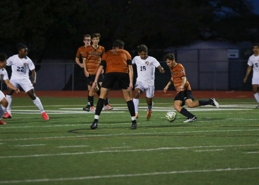 Luca Cipleu '21 tries to kick the ball past the defender. This was during the first half of the game, so the energy was high.