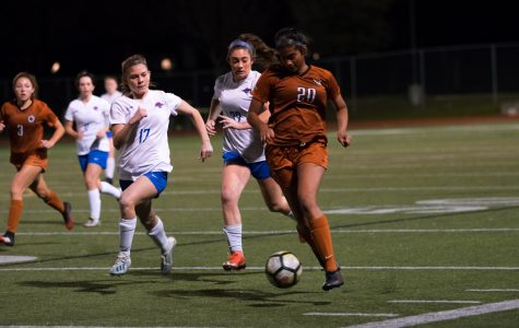 With two opposing defenders on her right side, Anisha Chintala '21 sprints with the ball downfield. Closer to the Lions' goal, Chintala would make a pass cross field in attempt to set up a shot, but was unsuccessful.