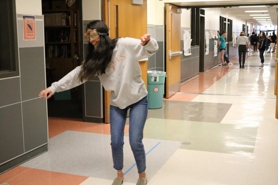 Sara Ali '20 loses balance as she stands on the balls of her feet. All the students in the experiment made more infractions than correct steps.
