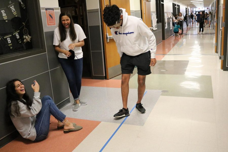 Areeb Ali '20 tries to stare at the blue tape through his glasses but finds it very difficult. The students hypothesis testing were mostly similar because of the multiple fails by all of the students.
