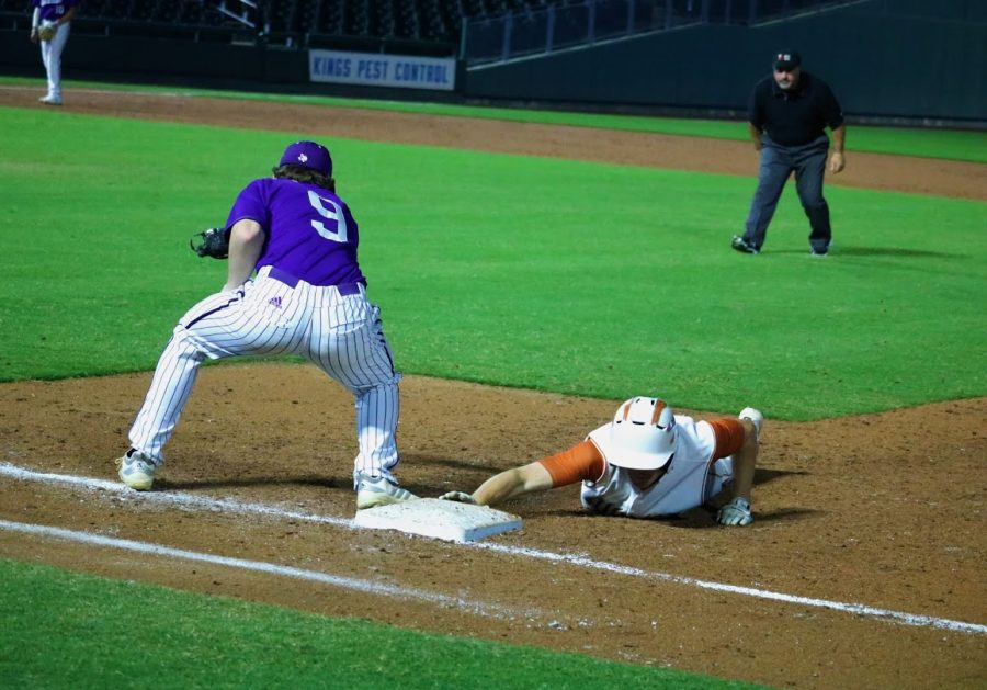 Kolton Clements '22 dives back into first after a pickoff attempt. Clements reached base before that on a walk.