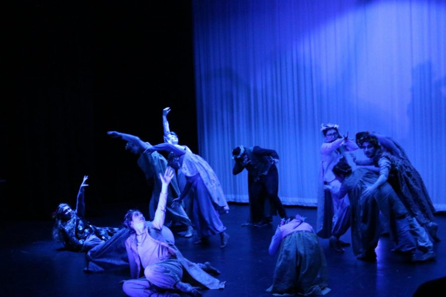 The group poses in the blue lighting showing the despair and conflict on the way to reaching through the valleys. Each student characterizes their bird in a different way.