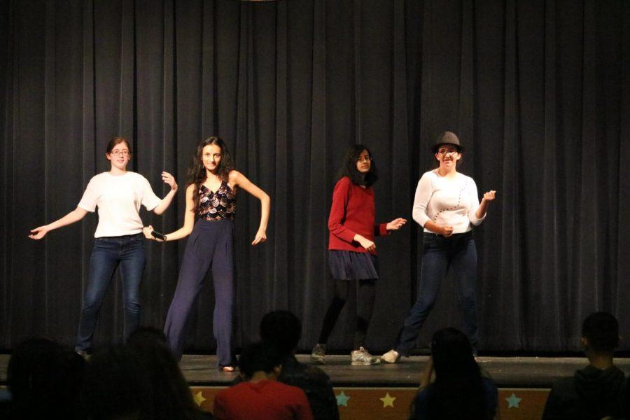 Showing off their Latin dance moves. Sacala A Bailar performs Latin American dances