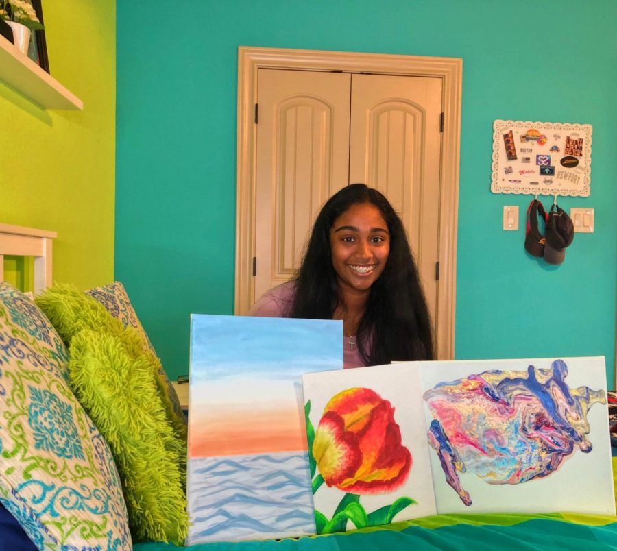 Displaying her original artwork, Anika Rajkumar '22 took to TikTok in search of fun activities to combat boredom, later finding a new passion  for painting. Photo courtesy of Anika Rajkumar.