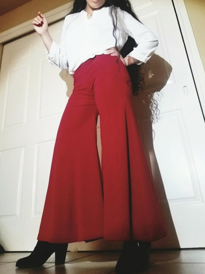 Alysa Hernan '21 poses in her red '80s style pants that she created out of an old dress. Photo Courtesy of Alysa Hernan