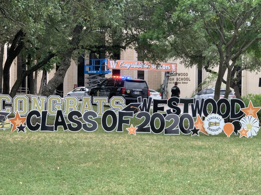 Seniors Attend Drive-Through Cap and Gown Pickup