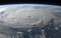 Overhead image of a hurricane, taken from a satellite.