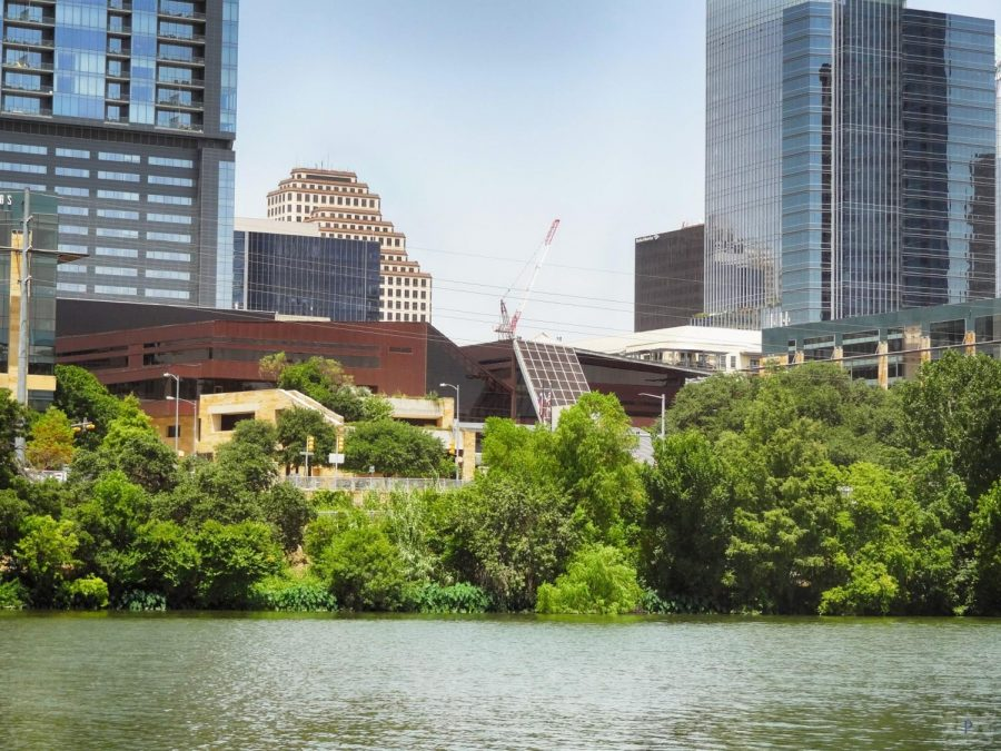 A view of Austin's City Hall from the shore of Lady Bird Lake.