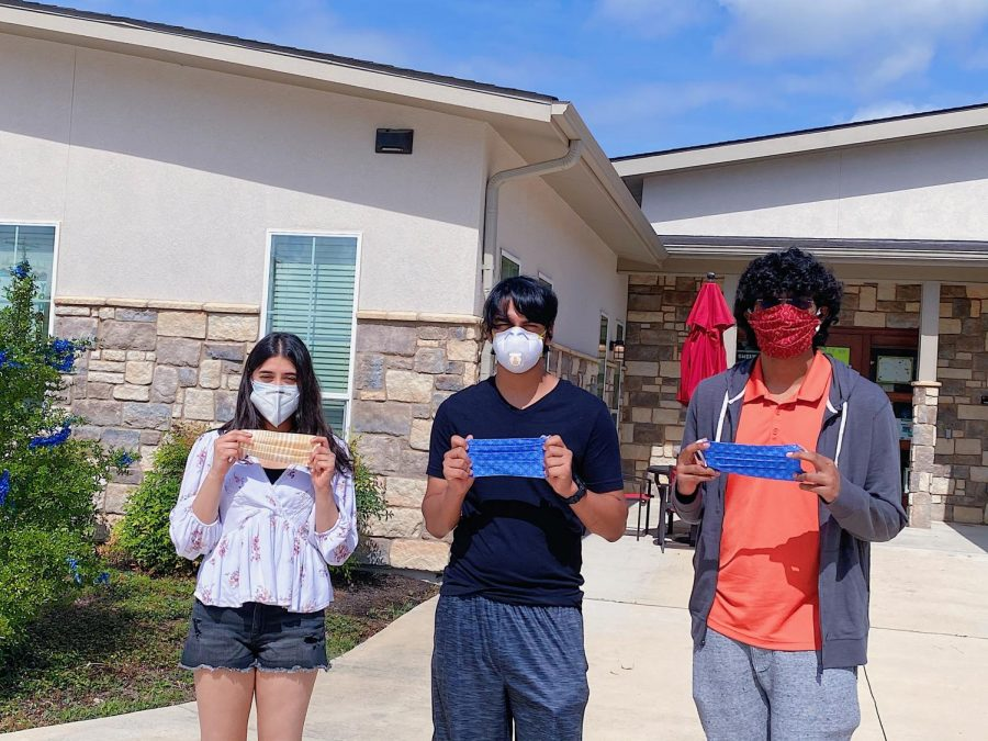 Lipika Chatur '21, Rushil Patange '21 and an organization volunteer stand outside of Sundara Senior Living, where Ma(s)king a Difference recently donated 100 masks.