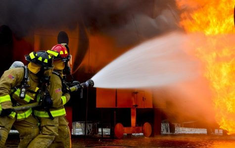 Firefighters combat an industrial fire.