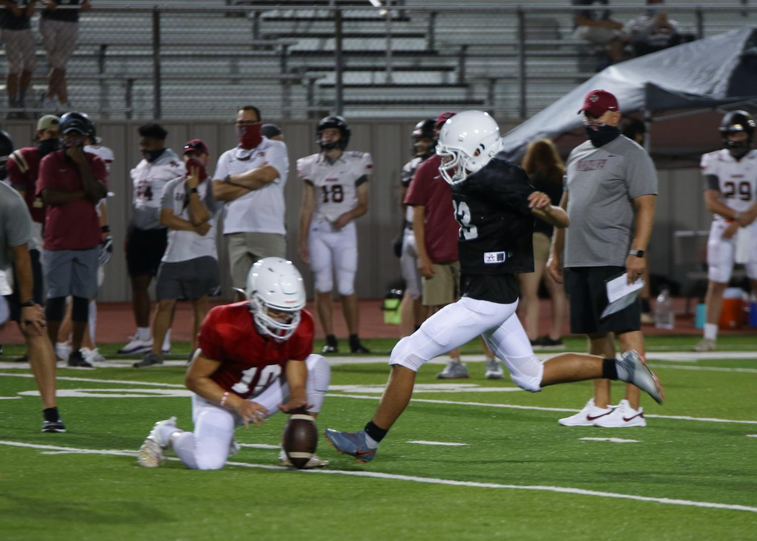 GALLERY%3A+Varsity+Football+Faces+Off+in+Preseason+Scrimmage+vs.+Rouse