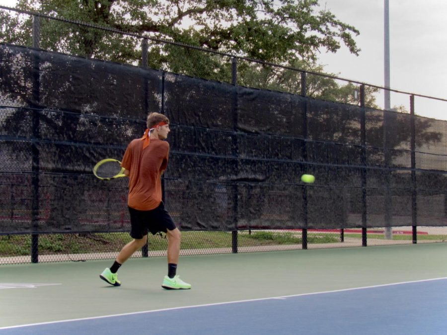 As the ball soars towards him, Nicolas Pesoli '21 winds up to send the ball across the net. This was one of his two winning matches of the day.