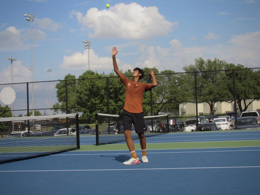 With a strong toss-up, Aashish Dhanani '22 prepares to serve the ball. After trouncing Round Rock, the varsity team rode their hot streak to a dominant victory over Vandegrift.
