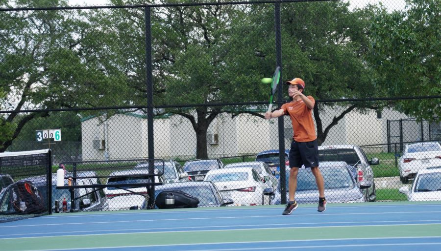 With a backhand hit, Daniel Xiong '21 returns the ball across the net. The tennis department has adjusted well to the season this year, considering the circumstances with COVID-19.