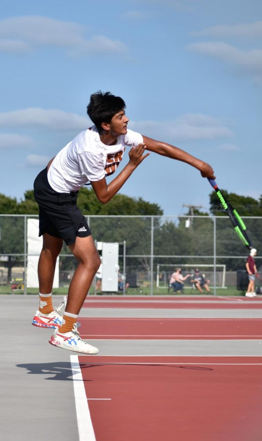 Reaching maximum extension, Aashish Dhanani '22 jumps to execute a powerful topspin serve. Dhanani partnered with Gina Mepham '23 for the first time in mixed doubles.
