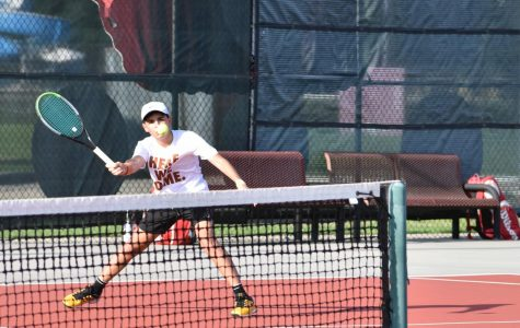 Eyeing the ball, Alek Mesarovic '24 split steps in preparation to frame a forehand volley return to his opponent. Playing singles in his first ever varsity match, Mesarovic battled his nerves to emerge triumphant with a score of 8-4.
