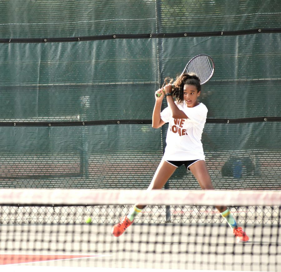 Pushed out wide, Alex Mepham '24 tracks the ball after a backhand return. Playing both doubles and singles, she would win this match 8-5.