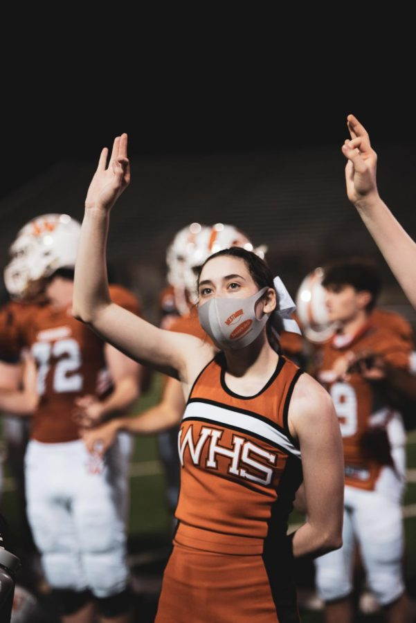 After the win, cheerleader Claire Fleming '21 puts her hand up in honor of the school's alma mater. The song is played at the end of every win, as well as at the end of pep rallies.