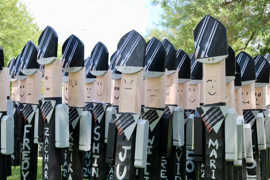 Finished blockheads cheerfully drying in the sun patiently waiting for their owners to pick them up.