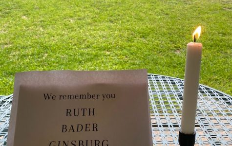 Keana Saberi '21 lights a candle in honor of Ruth Bader Ginsburg's death during her virtual event.
