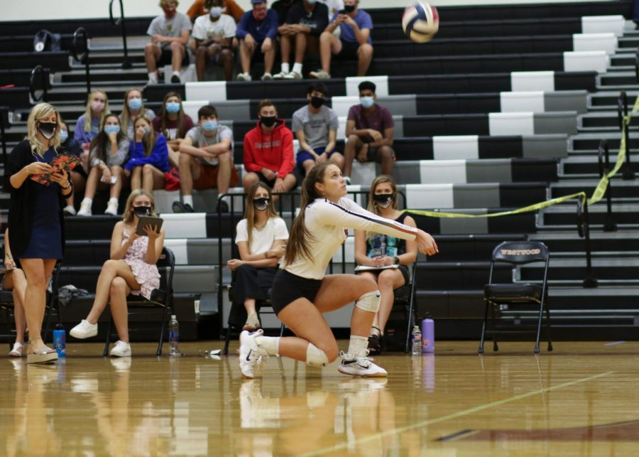 Kneeling, Abby Gregorczyk '21 gets ready to bump the ball to someone else on her team against Hutto on Friday, Oct. 2. Due to a positive COVID-19 test occurring in the team, play will be postponed until at least Saturday, Oct. 17.