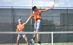 Leaping to poach the ball at the net, Nicolas Pesoli '21 extends with a backhand volley to put away the ball. This season marks the first year that Pesoli has played for a high school tennis program.