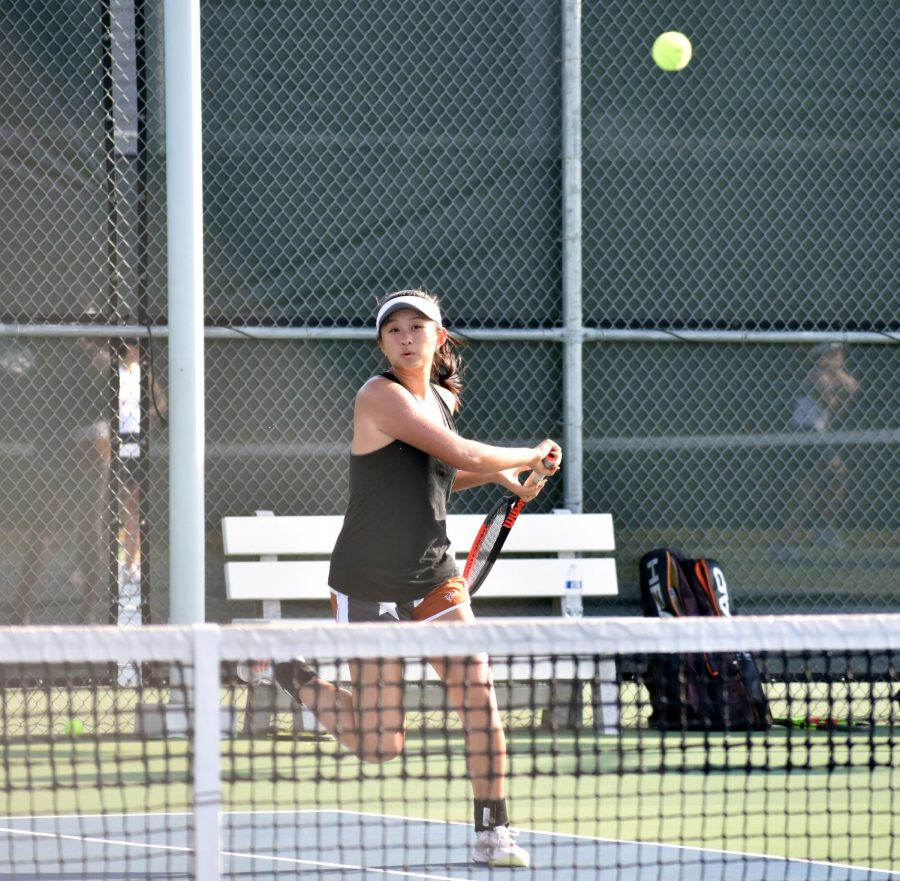 Following through on a cross-court forehand return, Jessica Lu '21 works to move her opponents around with expansive full court coverage. Partnering with freshman Dana Kardonik, their individual consistencies would gel in their favor, winning 6-0, 6-0.