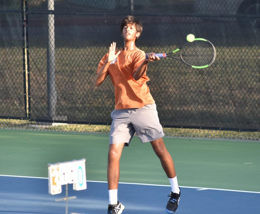 Driving forward with his racket, Aashish Dhanani '22 makes a forehand return to his opponent. Though his partnership with Gina Mepham '23 in mixed doubles was only created at the beginning of the fall season, they've come to make a good team, prevailing in their match 6-0, 6-0.