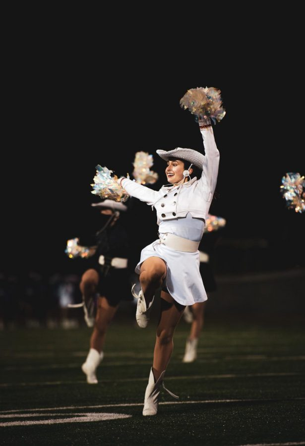 Laney Popps '21 performs during halftime with the rest of her Sun Dancer team. Due to game rescheduling their performance was pushed two weeks forcing them to perform in the chilly weather.