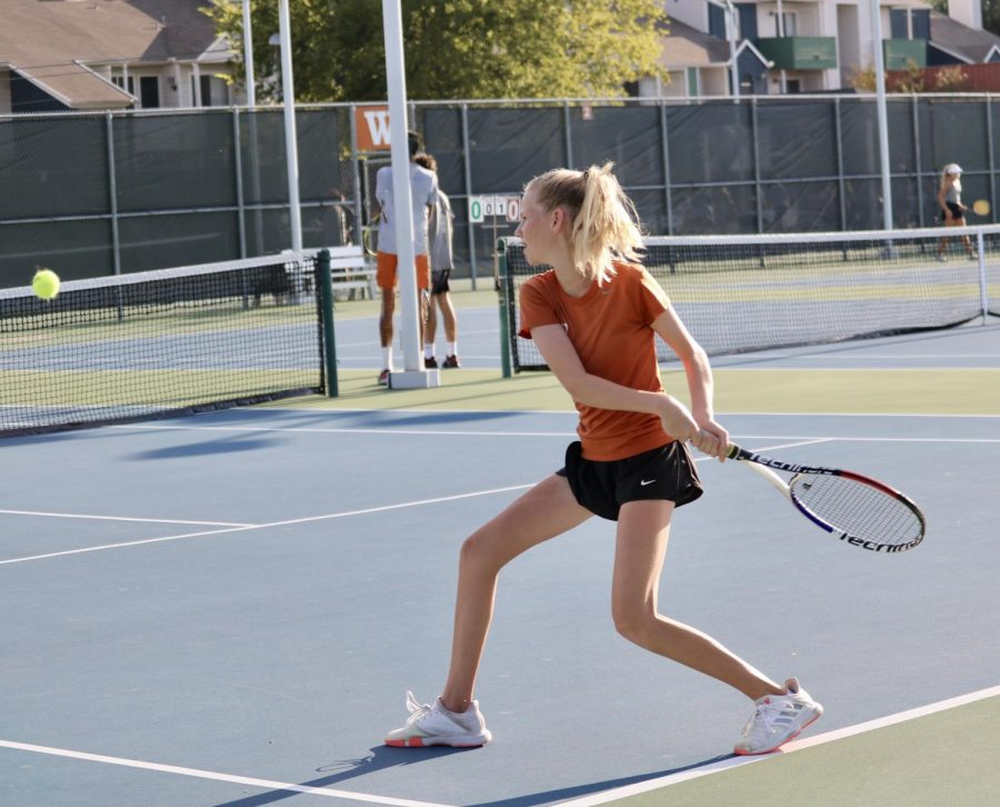 Dana Kardonik '24 tracks the ball moving towards her, stepping up with her racket laid back to brush a heavy topspin shot on her strings. She would take the first set with a score of 6-1, but didn't complete the match as the Warriors had already won.