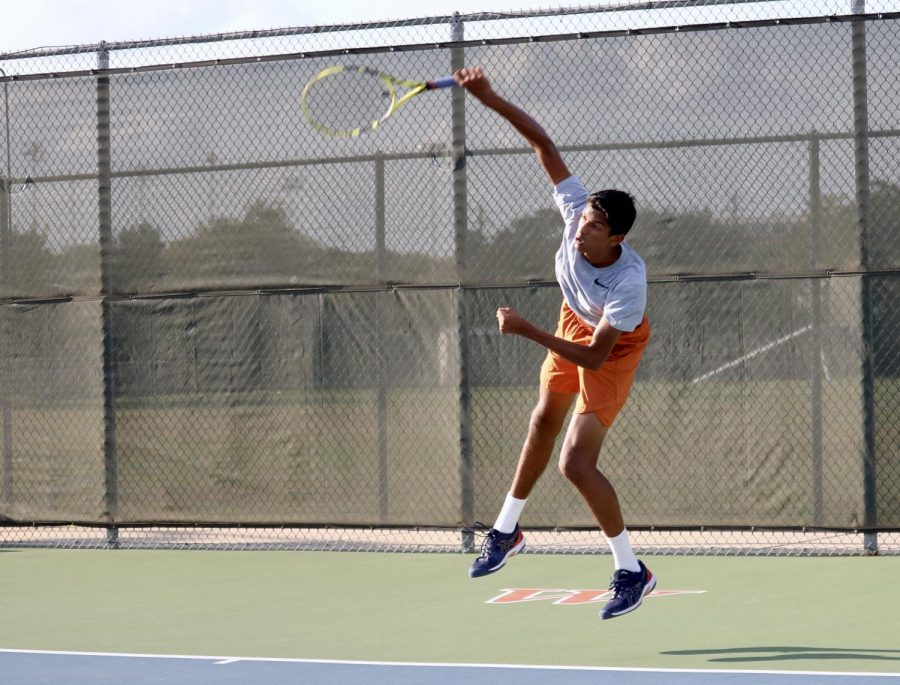 """Sachchit Sivaram '21 explodes off the ground to serve an ace towards his opponent. He would easily win his singles match 6-1, 6-0. """"I've just gotten a lot more mentally strong. I think I've had the skills and the physical part of it, but I just needed to trust myself and the mental aspect and I think I've gotten there,"""" Sivaram said."""