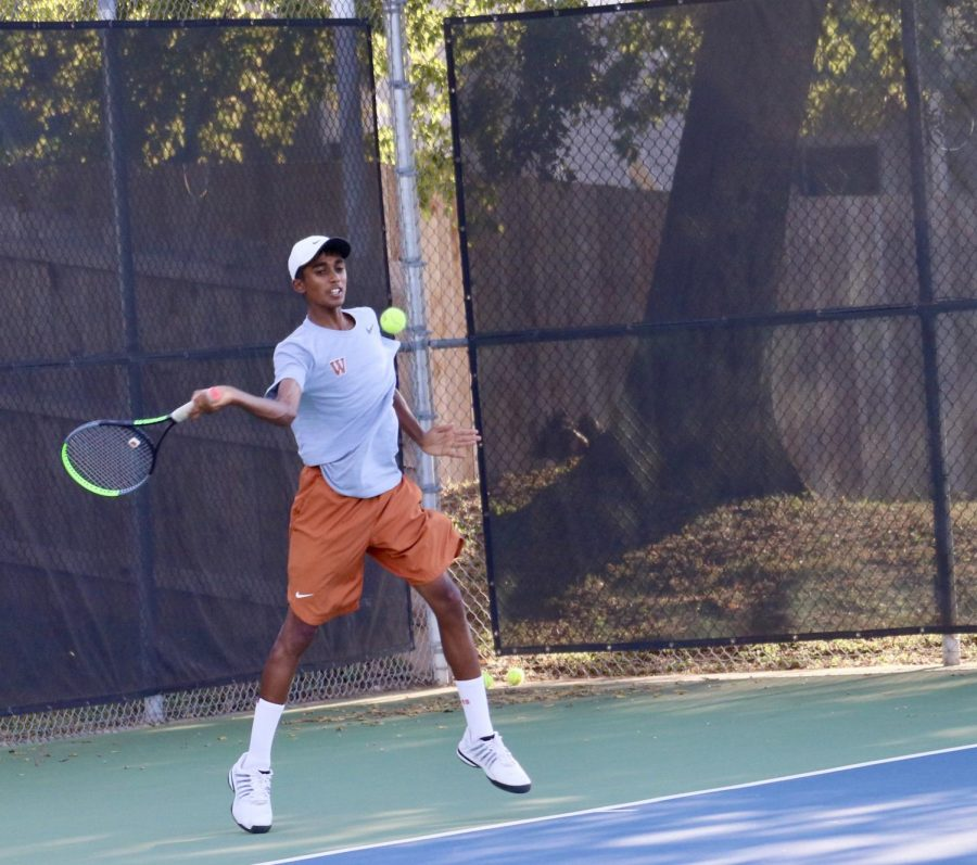 """Aadhi Raja '23 forehands the ball, making a powerful cross-court return towards his opponent, forcing an error. He won his doubles and singles swiftly with a score of 6-1, 6-0. """"I feel like I've gotten just more consistent in general and I've worked on my fitness so I can keep my balls in play,"""" Raja said."""